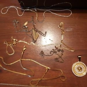 Other - 6 fake gold chains and 3 pendants